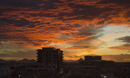 Twilight over North Scottsdale, Az,USA. Dramatic orange and red cloudscape twilight over North Scottsdale, Az,USA Royalty Free Stock Photos