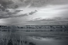 Twilight over pond. IR photography. Royalty Free Stock Photos