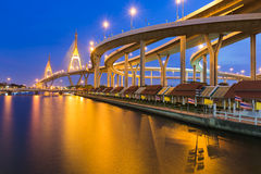 Twilight over, Suspension bridge connect to highway water front, Bangkok Thailand Stock Photo