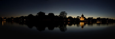 Twilight panorama. With shadows of land reflected on water Stock Photography