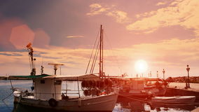 Twilight in the peaceful fishing port. Fishing boats anchored in a peaceful Mediterranean port at the sunset,video clip stock footage