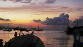 Twilight in the peaceful fishing port. Fishing boats anchored in a peaceful port at the sunset. 3840x2160, 4k. Twilight in the peaceful fishing port. Fishing stock video footage