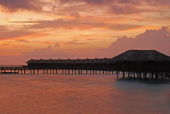 Twilight Phenomenon with Overwater Bungalow and Dramatic Sky Stock Images