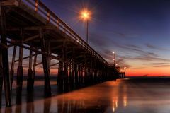 Twilight at pier. Tranquil scene of Newport beach pier after a sunset Stock Images