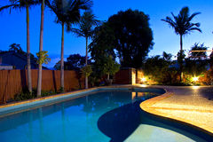 Twilight Pool. Tropical swimming pool at Twilight Stock Photo