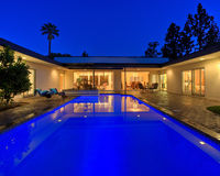 Twilight pool house Stock Images