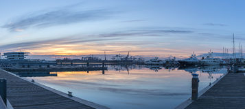 Twilight in the port of Valencia cranes working loading transport ships skyline reflected, gigapan Stock Images