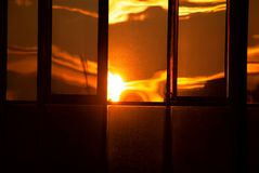 Twilight reflection in window. Beautiful eavening with sun light reflected in the window royalty free stock photo