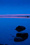 Twilight on the river. Pink sunset strip in a twilight shoot Stock Images