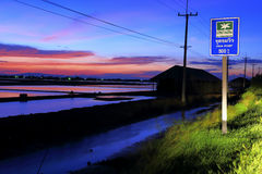 Twilight at salt field in Thailand Royalty Free Stock Image