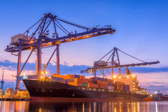 Twilight scene beside of the cargo ship terminal. Royalty Free Stock Photos