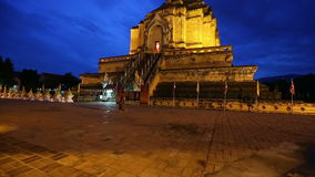Twilight scene of Wat Chedi Luang, Thai temple, Chiang Mai, Thailand. (Panning stock footage