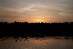 Twilight ,Sea ,Tree, the dawn sun . Overcast. Royalty Free Stock Photography