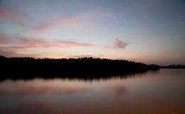 Twilight ,Sea ,Tree, the dawn sun . Overcast. Royalty Free Stock Photo