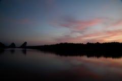 Twilight ,Sea ,Tree, the dawn sun . Overcast. Royalty Free Stock Images