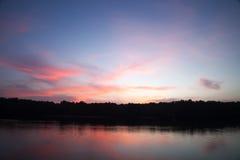 Twilight ,Sea ,Tree, the dawn sun . Overcast. Stock Photo
