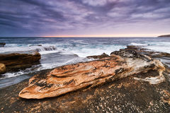 Twilight seascape with rocks Royalty Free Stock Image