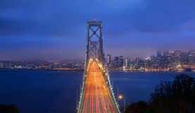 Twilight Shot of Bay Bridge. OAKLAND, CA - JUNE 10, 2015: The San Francisco–Oakland Bay Bridge is a complex of bridges spanning San Francisco Bay in California Royalty Free Stock Images