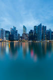 Twilight Singapore city downtown sea front light reflection Royalty Free Stock Photography