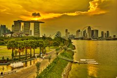 Singapore Marina Barrage Dam. Twilight of Singapore cityscape. Central district business skyline from recreation area in Marina Barrage, a dam in Singapore at stock photos