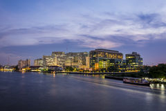 Twilight at Siriraj hospital with a light trail of boat in Chao Praya river Royalty Free Stock Images