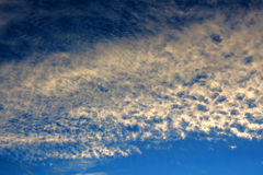 Twilight sky with bright cirrus clouds Stock Image