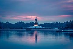 Twilight sky and Buddha statue at PhutthamonthonBuddhist park in Nakhon Pathom Province of Thailand. Phutthamonthon is a Buddhist park in Phutthamonthon district Stock Photos