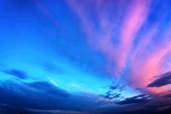 Twilight sky in deep blue and pink. Twilight sky background in deep blue with vivid pink clouds Royalty Free Stock Photography