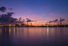 Twilight sky over oil refinery station Stock Photos