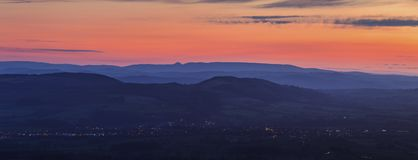 Twilight Sky over Shropshire Hills in United Kingdom. Twilight sky over Area of Outstanding Beauty with Lights of Ludlow Town Stock Images