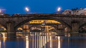 Twilight sky scene of Ponte Alla Carraia and Santa Trinita Holy Trinity Bridge day to night timelapse over River Arno. Twilight sky scene of Ponte Alla Carraia stock video