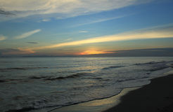 Twilight sky at shore Stock Image