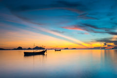 Twilight sky and silhouette fishing boat. Beautiful silhouette fishing boat in lake at Twilight sky. landscape Chumphon Thailand Stock Photo