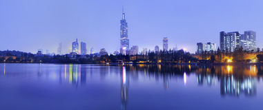 Twilight skyline reflected in a tranquil pond, Nanjing, China. Twilight skyline reflected in calm water, Nanjing, China Stock Photography