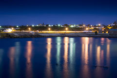 Twilight in South Africa. Harbour of Gansbaai (South Africa) at sunset royalty free stock image