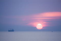 Twilight Sunset. Fishing Boat At Twilight And Sunset stock image