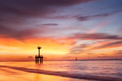 Twilight after sunset on the beach with lighthouse Royalty Free Stock Photos