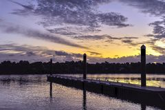 Twilight Sunset, at a Boat Marina, Calm Sea with Floating Pontoons Supporting a Jetty. royalty free stock photos