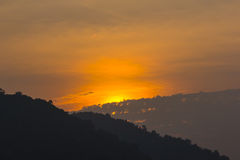 Twilight sunset in cloud and mountain Stock Images