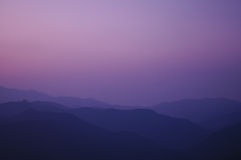 Twilight sunset at the peak of the mountain Royalty Free Stock Image