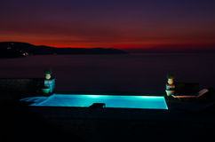Twilight sunset and pool. Amazing Twilight sunset and pool by the sea Stock Images