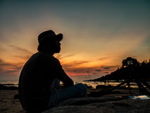 Twilight and sunset at the sea witj a man taking photo Royalty Free Stock Images