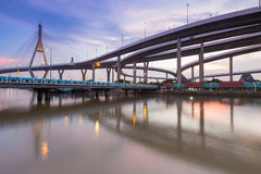 Twilight of Suspension bridge connect to Bangkok freeway overpass Stock Photos
