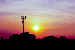 Twilight time of bangkok city with radio pole Stock Photo