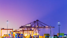 Twilight time at industrial port Stock Photos