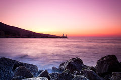 Twilight time on a rocky shore Royalty Free Stock Photos