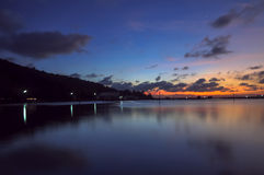 Twilight time on Songkhla lake, Thailand. Silhouette house at twilight time on the lake Stock Image