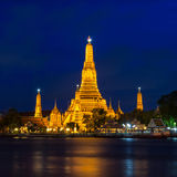 Twilight time of Wat Arun across Chao Phraya River in Bangkok, T Stock Photography