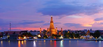 Twilight time of Wat Arun across ChaoPhraya River Royalty Free Stock Image