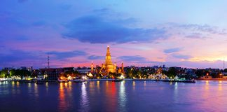 Twilight time of Wat Arun across ChaoPhraya River Royalty Free Stock Photo